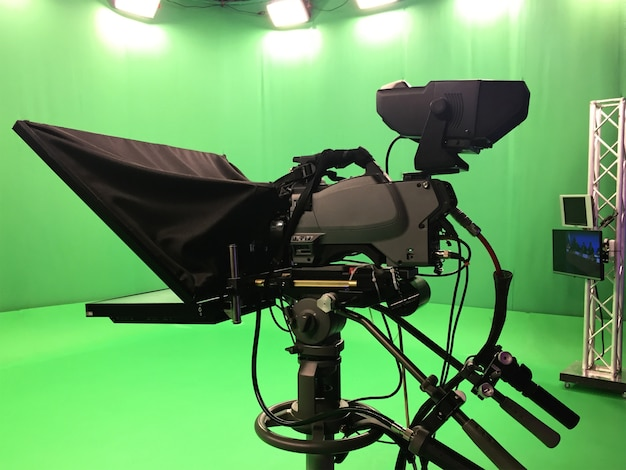 Modern empty green video recording and broadcasting studio with tv