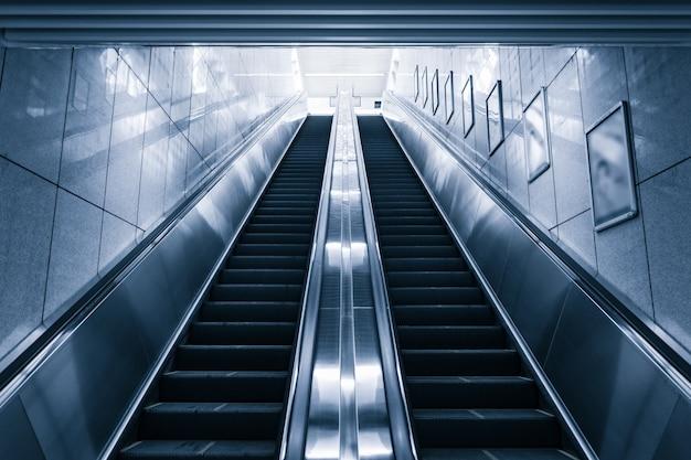 Modern escalator in shopping center Free Photo