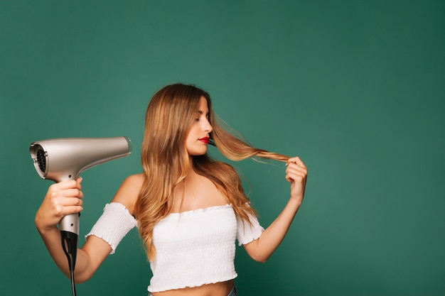 Modern girl with hairdryer Free Photo