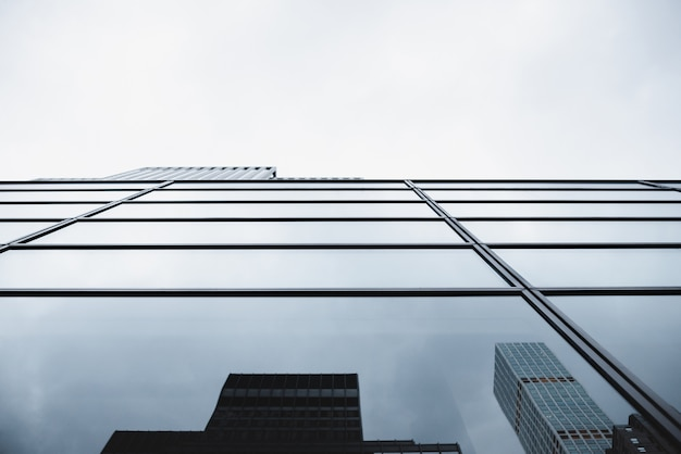 Modern glass building with reflections Free Photo