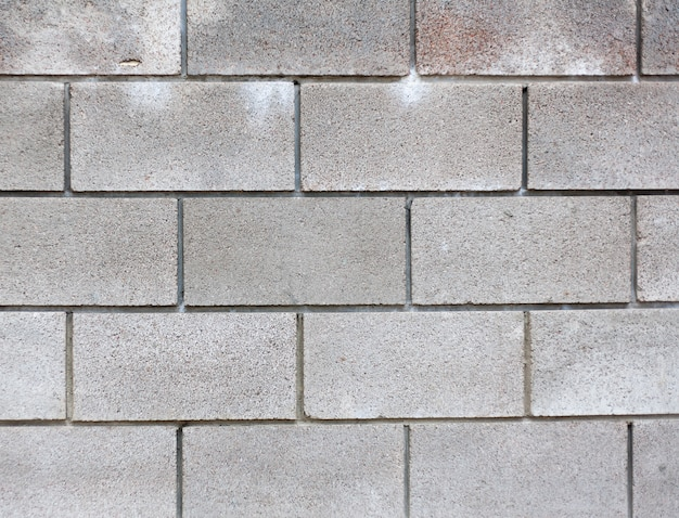 Modern grey brick wall for background texture Premium Photo