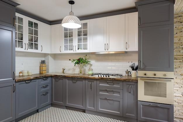 Modern Grey And White Wooden Kitchen Interior Premium Photo