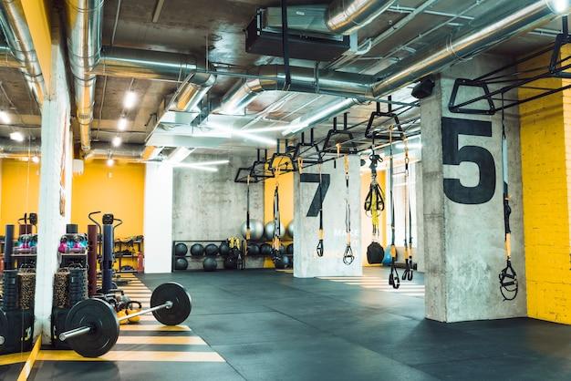 Modern gym with equipments Premium Photo