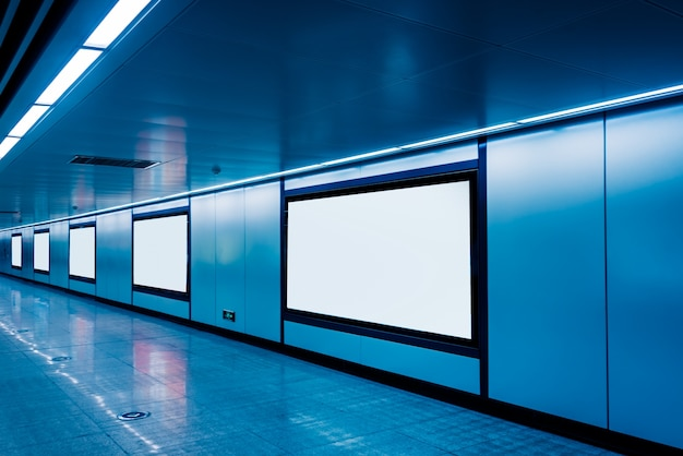 Modern hallway of airport or subway station with blank billboards Free Photo