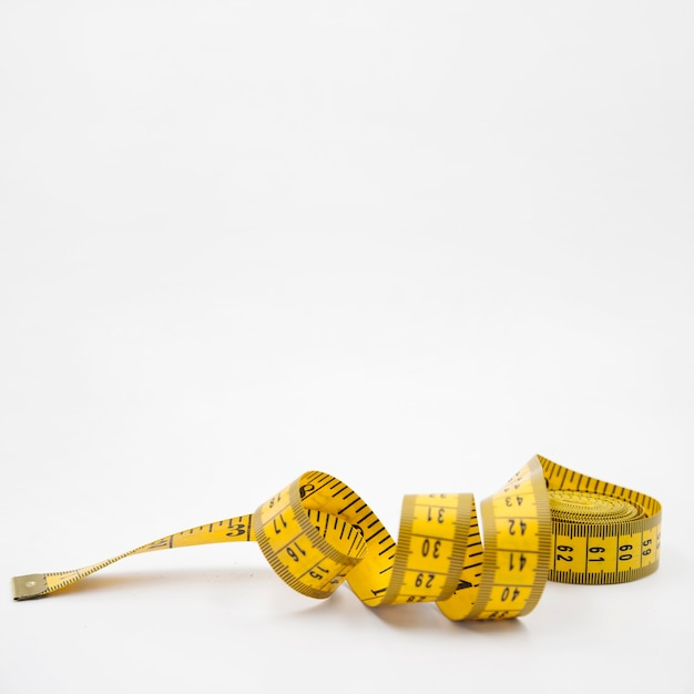 Modern healthy life composition with measure tape Free Photo