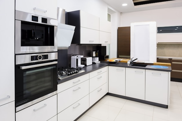 Modern hi-tek kitchen, clean interior design Premium Photo