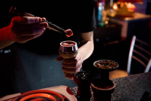 Modern hookah with coconut charcoal for relax and shisha smoke Premium Photo