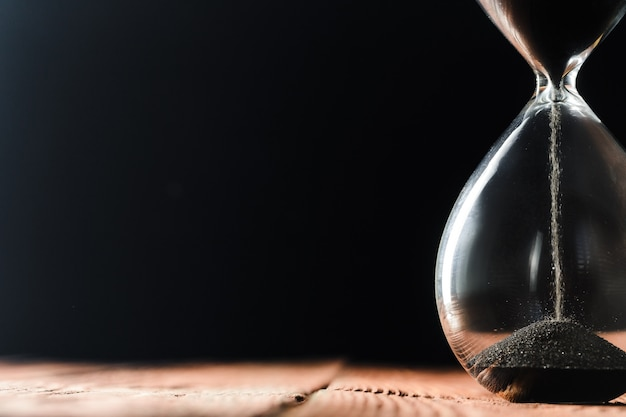 Modern hourglass on wooden Premium Photo