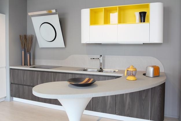 Modern kitchen white and yellow Premium Photo