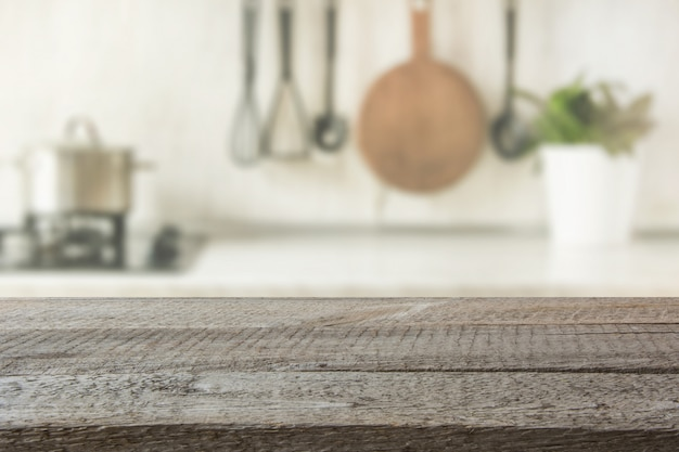 Modern kitchen with wooden tabletop, space for you and display products. Premium Photo