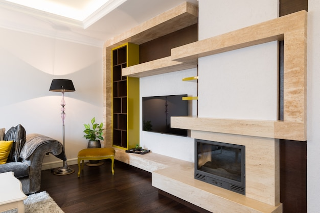 Modern living room interior with fireplace Premium Photo