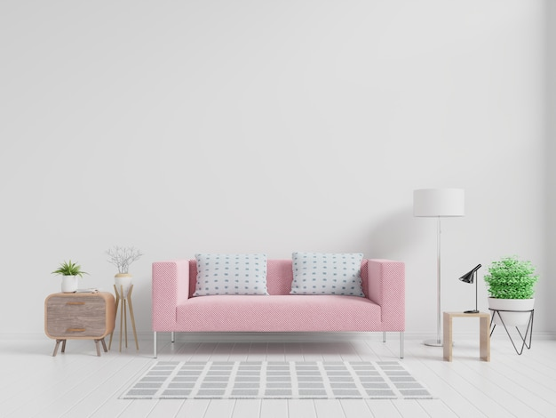 Modern living room interior with pink sofa and green plants, lamp, table on white wall. Premium Photo