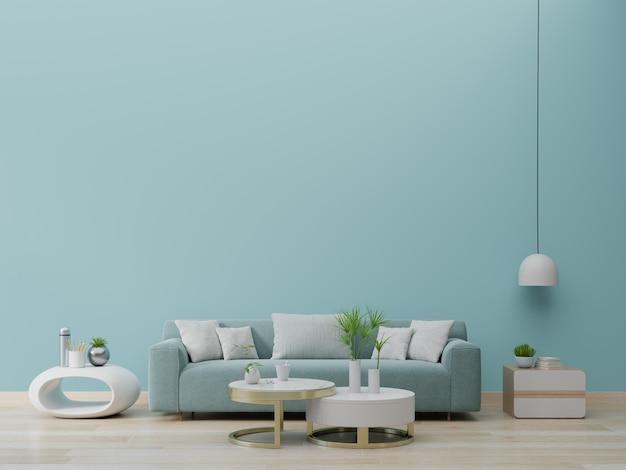 Современный интерьер живущей комнаты с софой и зелеными растениями, лампой, таблицей на предпосылке зеленой стены. Premium Фотографии