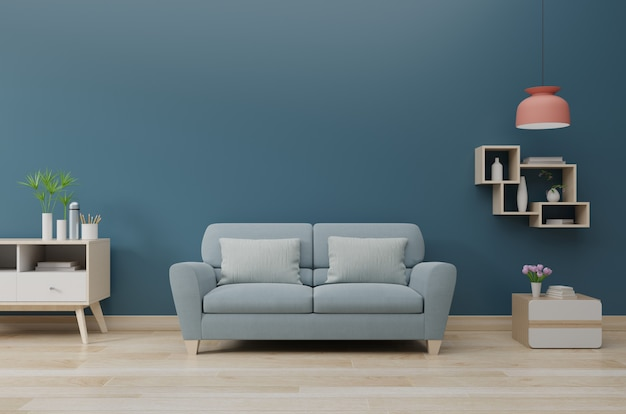 Modern living room interior with sofa and green plants, lamp, table on dark blue wall background Premium Photo