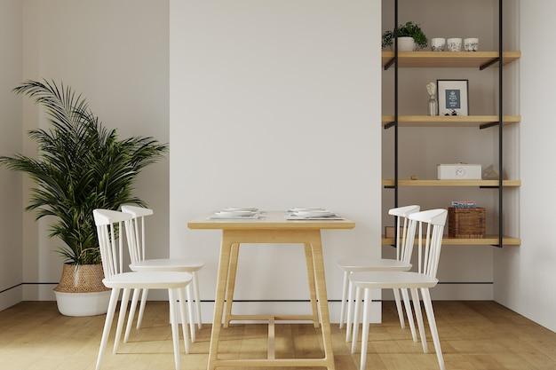 Современная гостиная со столом перед белой стеной Premium Фотографии