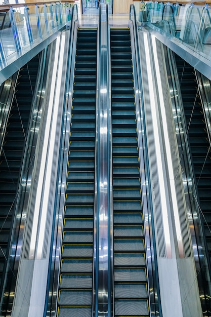Modern luxury escalators with staircase at airport Premium Photo