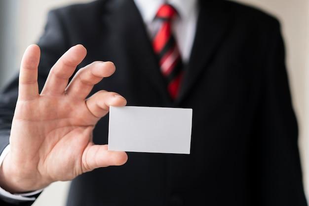 Modern man holding blank business card Free Photo