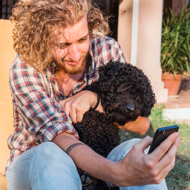 Modern man with dog in garden Free Photo