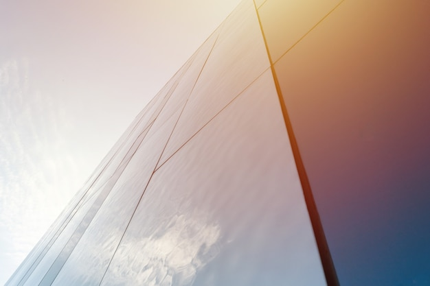Modern mirror wall decoration of business center, copy space. bottom view to texture of exterior design. contemporary pattern of buildings. looking up. Premium Photo