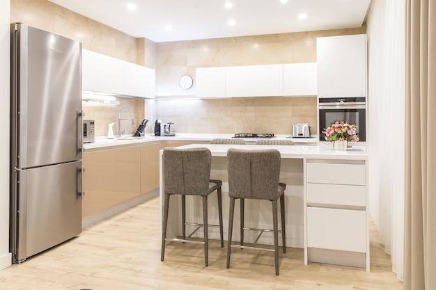 Modern new kitchen in a luxurious apartment Premium Photo