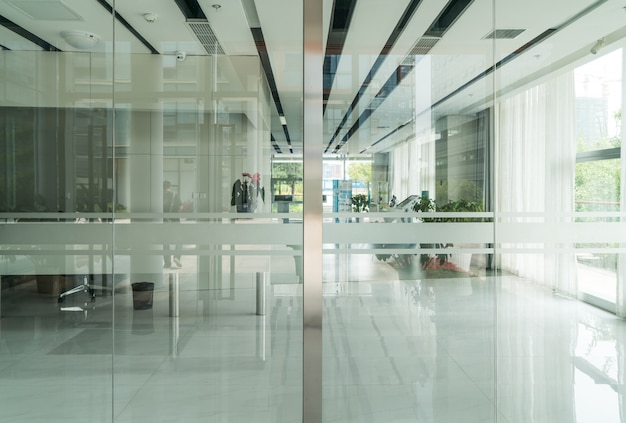 A modern office building with glass doors and windows Premium Photo