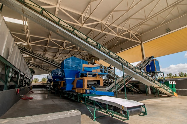 Modern processing unit machinery for olive oil Premium Photo