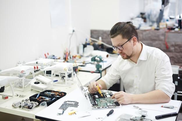 Modern prodigy disassembling electronics Free Photo
