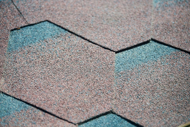 Modern roof shingles tiles, close up. soft asphalt roof background. new roofing construction. easy roofing repair. Premium Photo