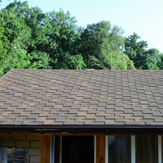 Modern roofing and decoration of chimneys. flexible bitumen or slate shingles Premium Photo