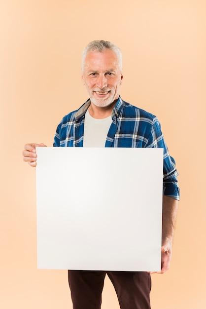 Modern senior man holding board template Free Photo