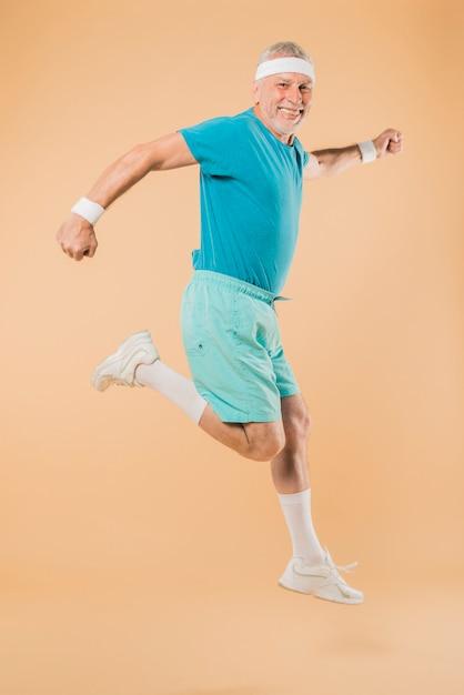 Modern senior man running Free Photo