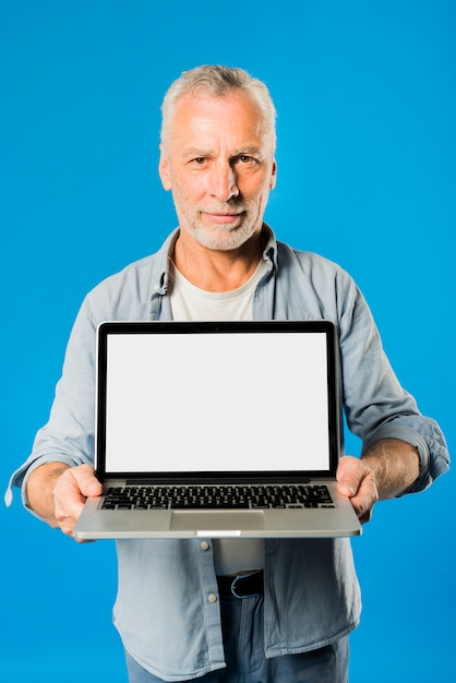 Modern senior man with laptop Free Photo