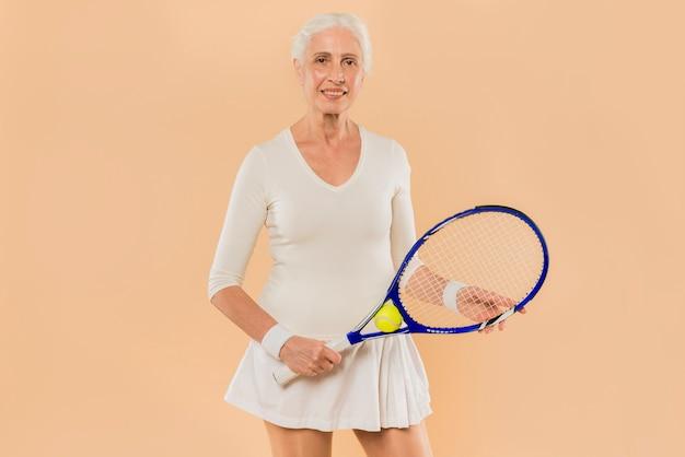 Modern senior woman playing tennis Free Photo