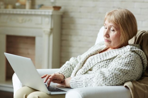 Modern senior woman surfing the net Free Photo