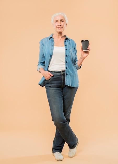 Modern senior woman with coffee cup Free Photo