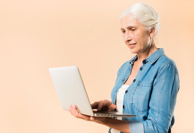 Modern senior woman with laptop Free Photo