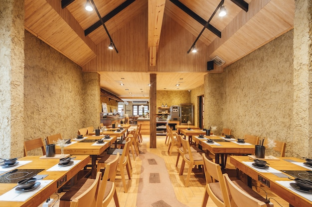 Modern shabu and sukiyaki restaurant decorated with wood and concrete, warm, cozy. Premium Photo
