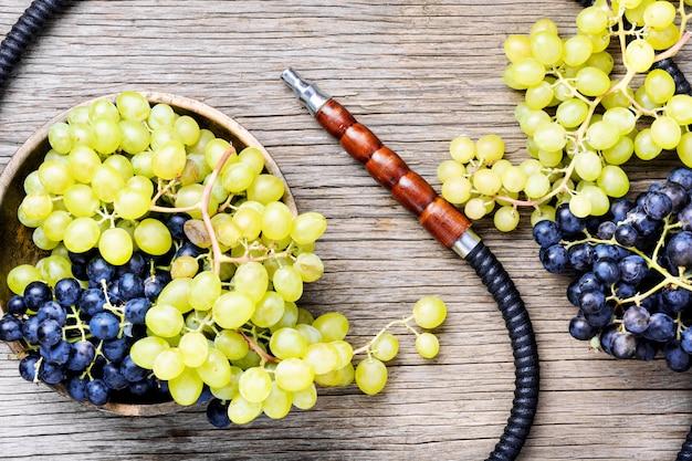 Modern shisha with grapes Premium Photo