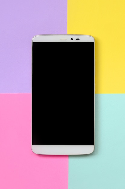 Modern smartphone with black screen onfashion pastel blue, yellow, violet and pink paper Premium Photo
