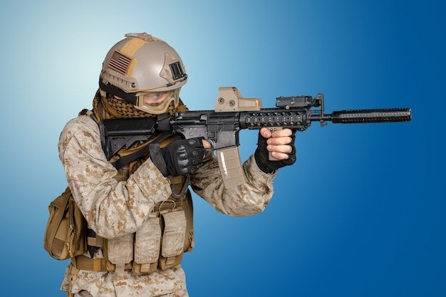 Modern soldier with rifle Premium Photo