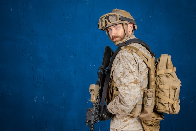 Modern soldier with rifle Premium Photo
