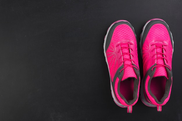 Modern sport composition with colorful trainers Free Photo