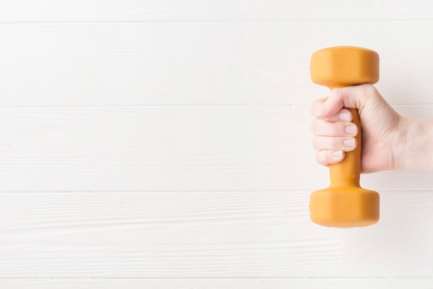 Modern sport composition with dumbbell Free Photo