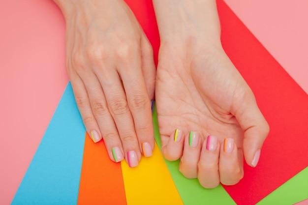 Modern stylish manicure rainbow or summer mood Premium Photo