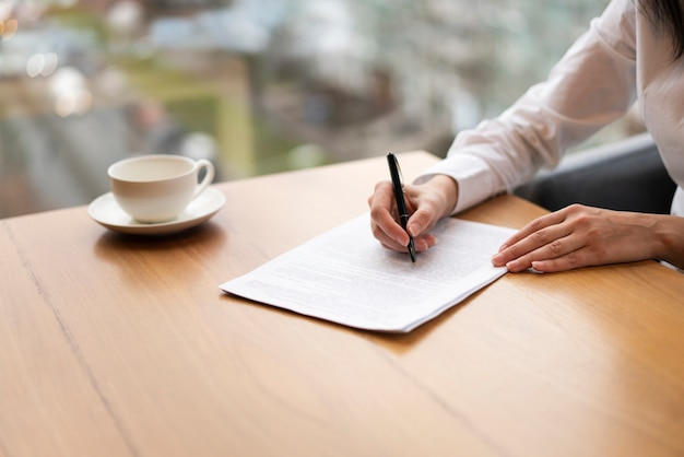 Modern unrecognisable woman taking notes Free Photo