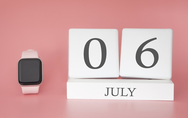 Modern watch with cube calendar and date 06 july on pink wall. concept summer time vacation. Premium Photo