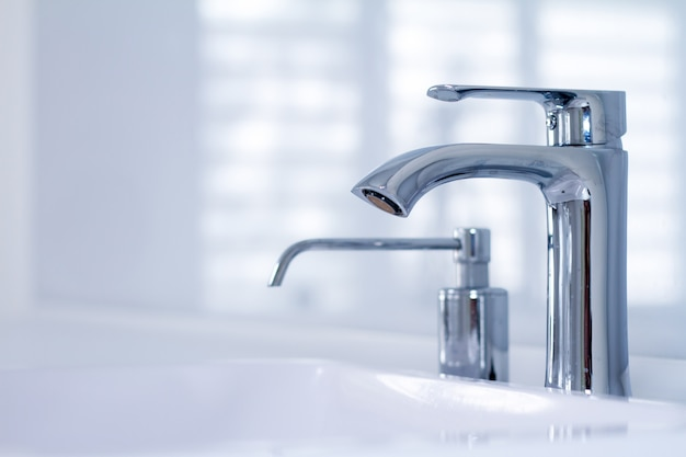 A modern water tap sink with faucet in minimalistic style Premium Photo