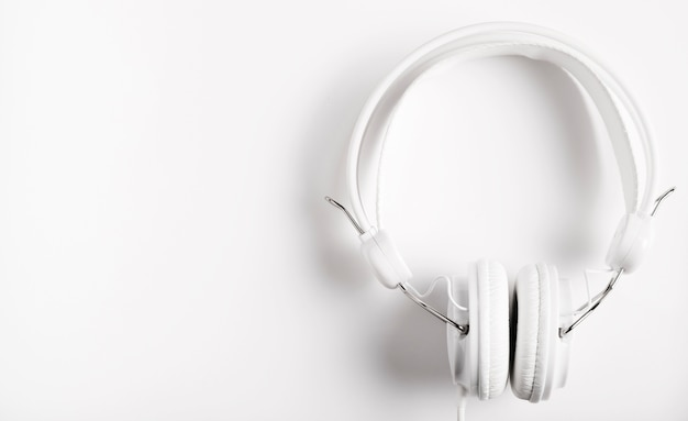 Modern white headphones for music Free Photo