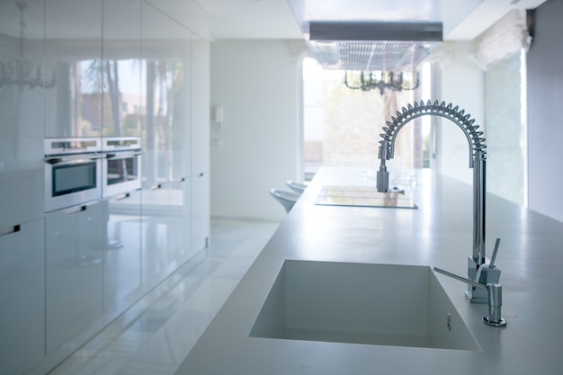 Modern white kitchen perspective with integrated bench Premium Photo