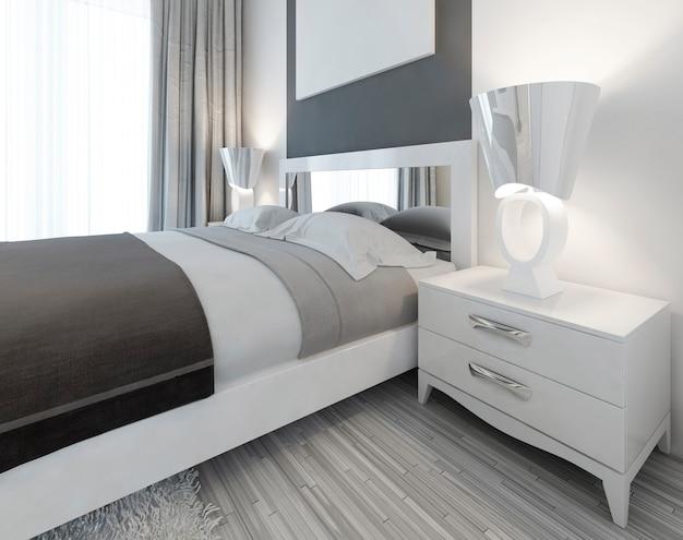 침실의 침대 옆에 램프가있는 현대적인 흰색 침실 용 탁자 현대적인 스타일입니다. 3d 렌더링. 프리미엄 사진